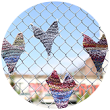Knitted Hearts on a Fence